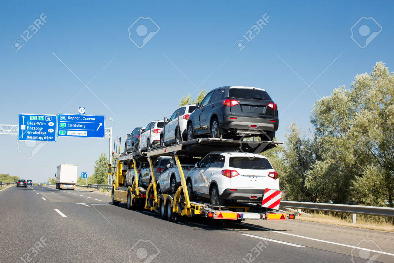 Car Carrier Trailer With New Cars For Sale On Bunk Platform... Stock ...