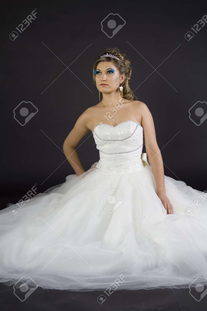 Young sexy girl in a wedding dress on a dark background Stock Photo - 17347315