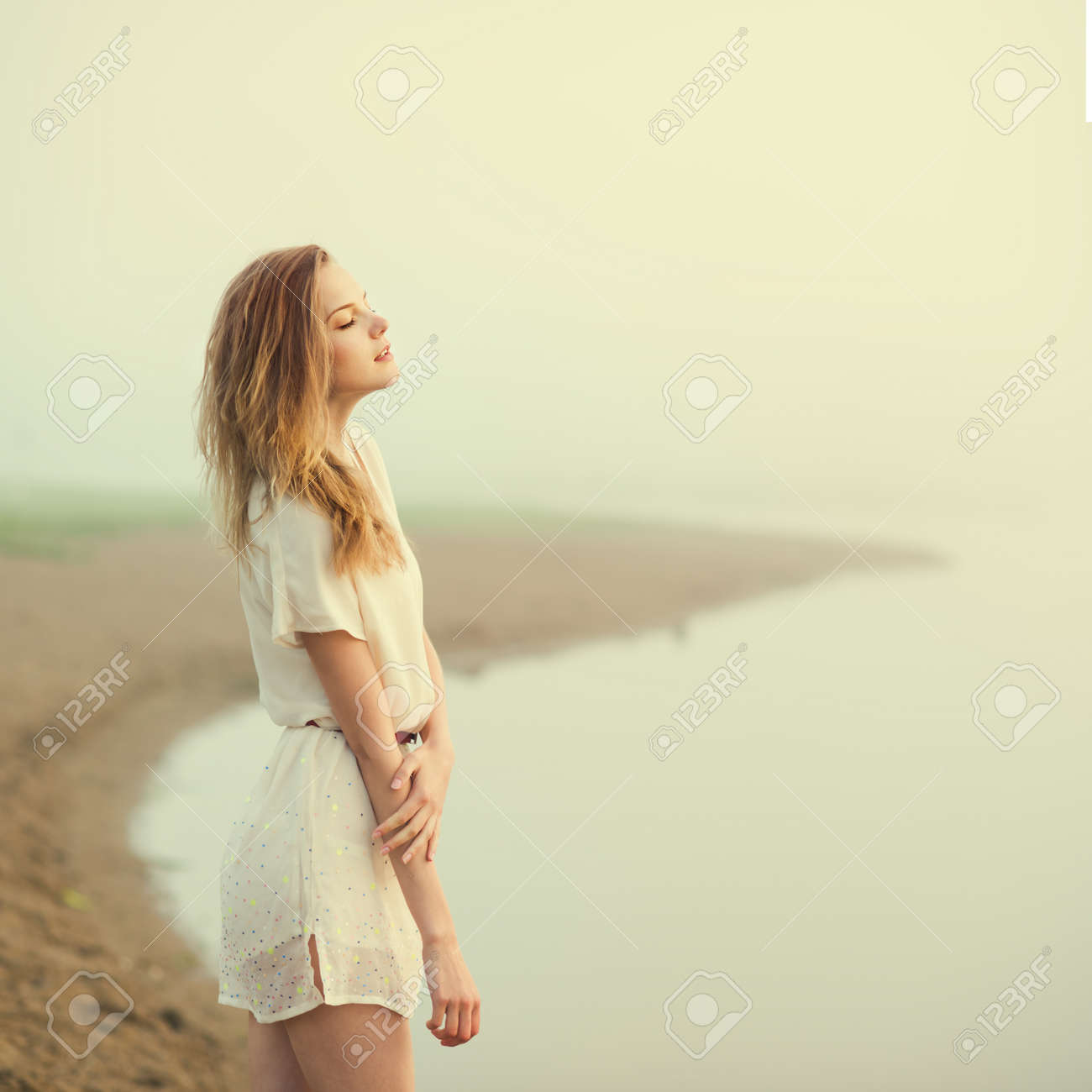 Beautiful sad girl in the morning on the beach stock photo 25985737
