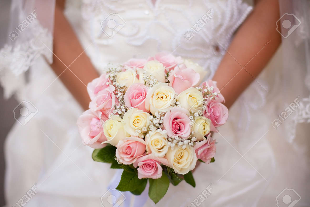 White and pink wedding bouquet with roses in hands stock photo stock photo white and pink wedding bouquet with roses in hands mightylinksfo