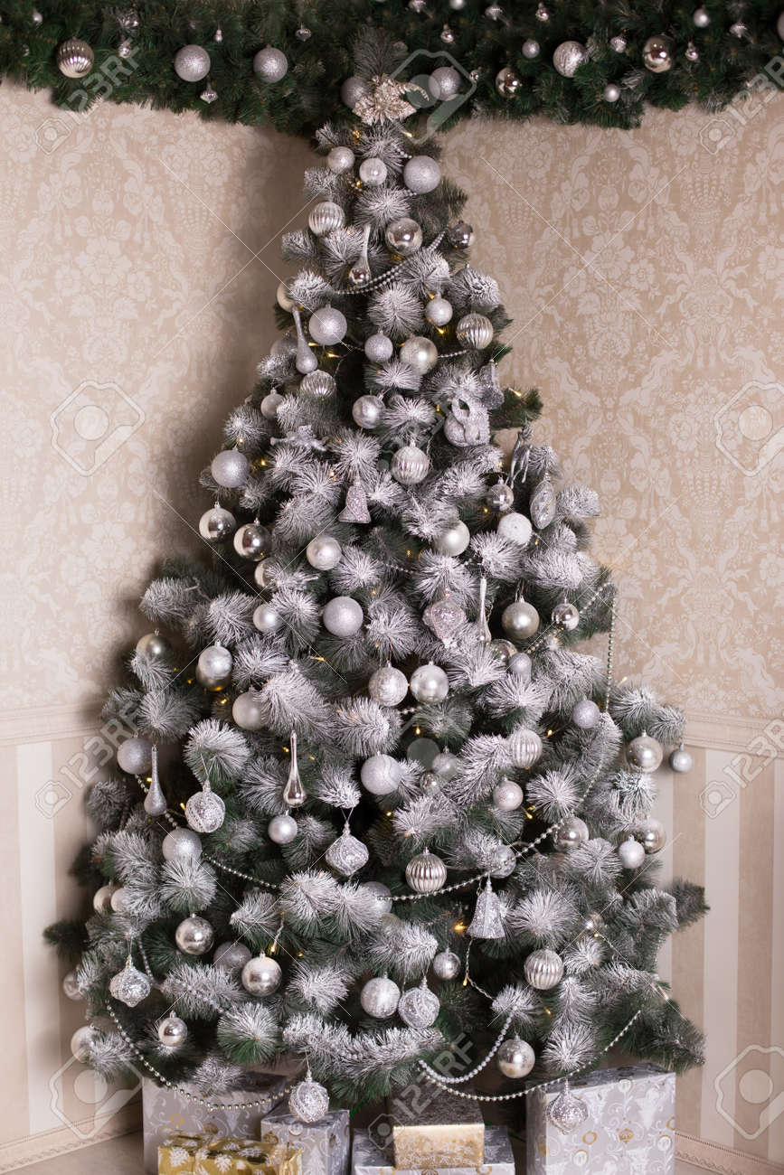 Decorated Christmas Silver Tree On Silver Decorations, Snowflakes ...