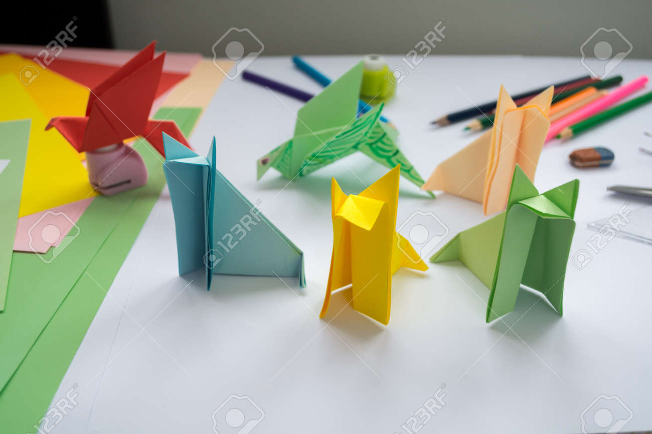 Childrens Origami Wolfs And Birds From Colored Paper Working