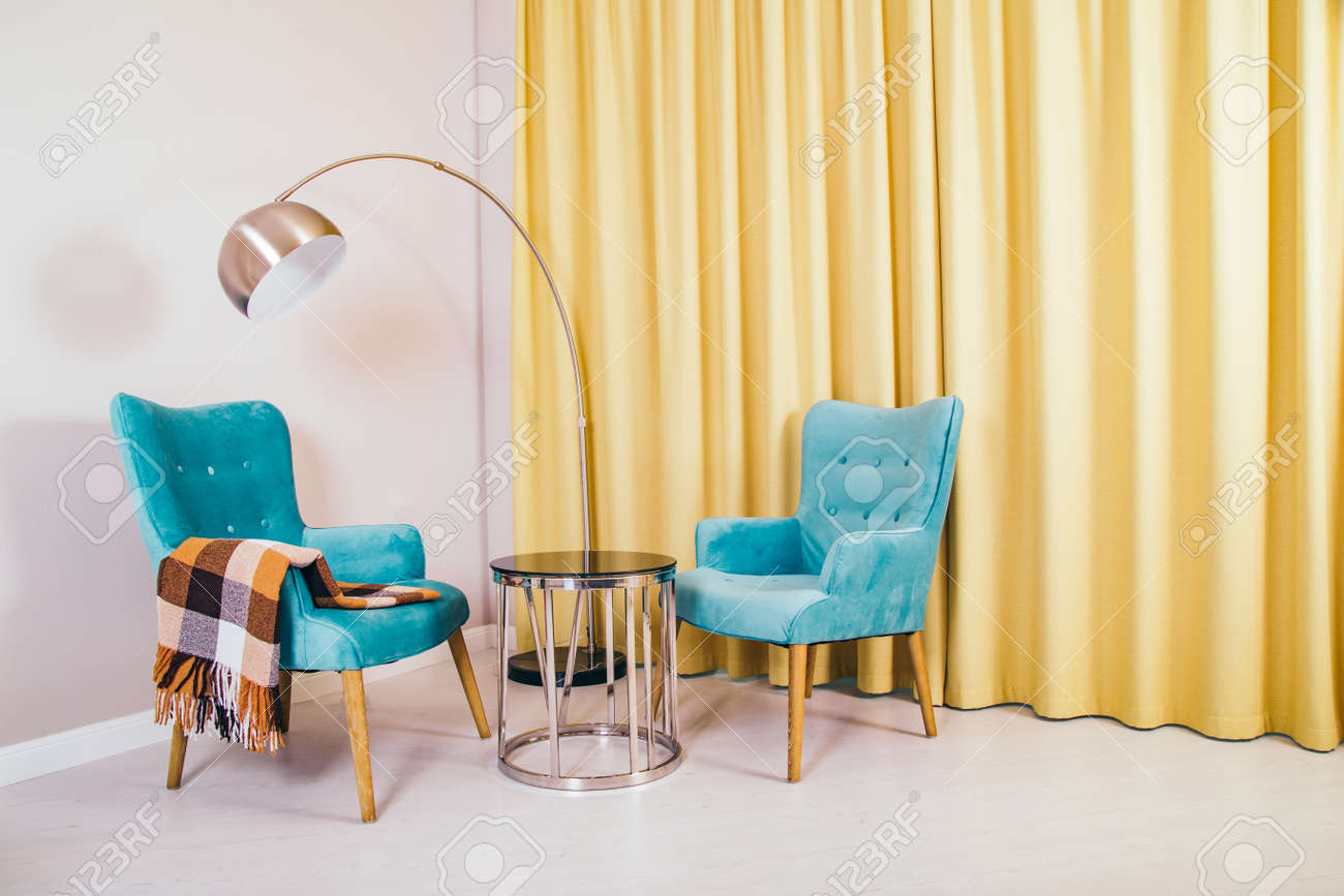 Conceptual Light Interior Of Living Room With Two Blue Armchairs