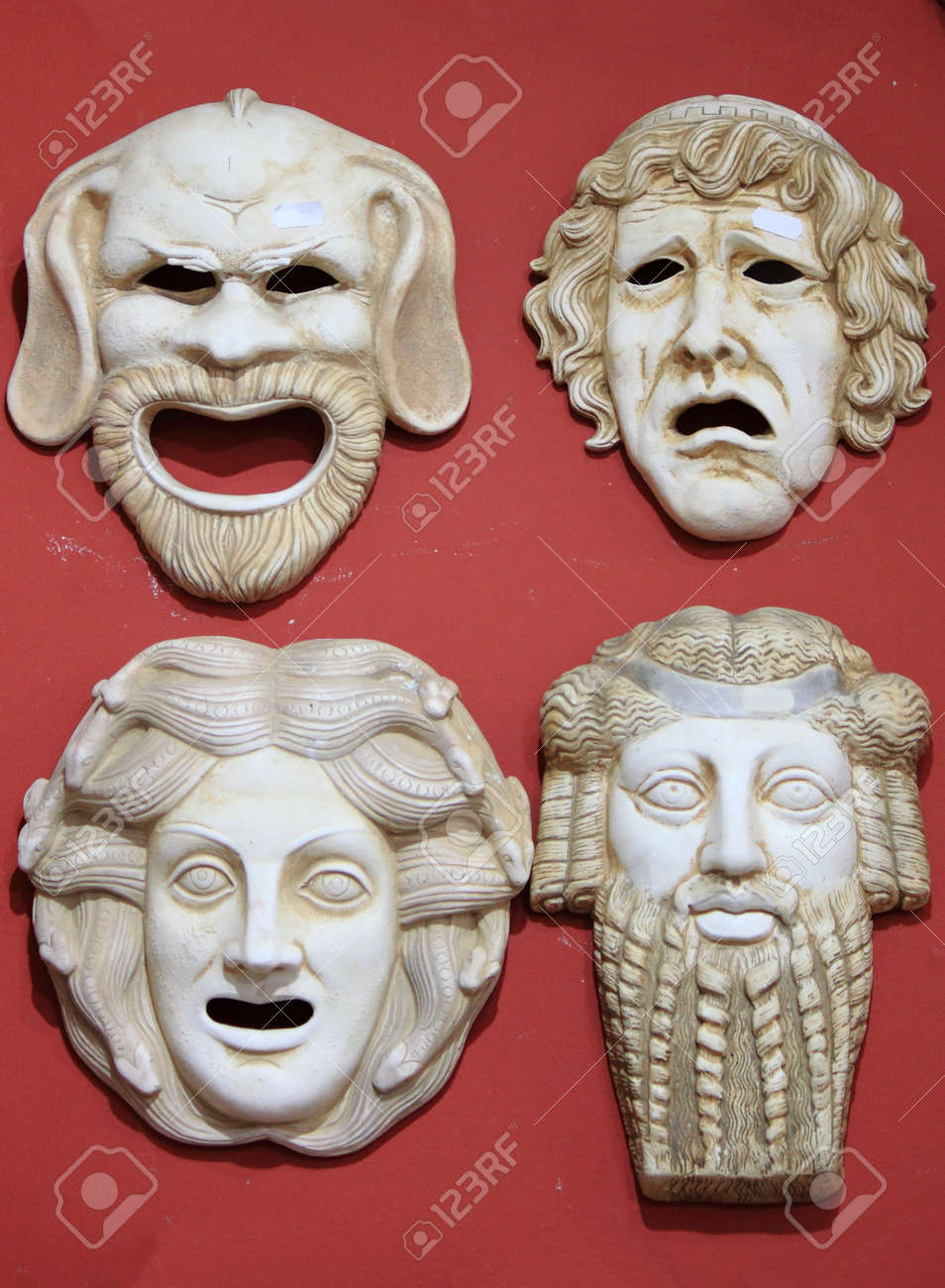 Ancient Greece theatre masks in marble stone - 14964017