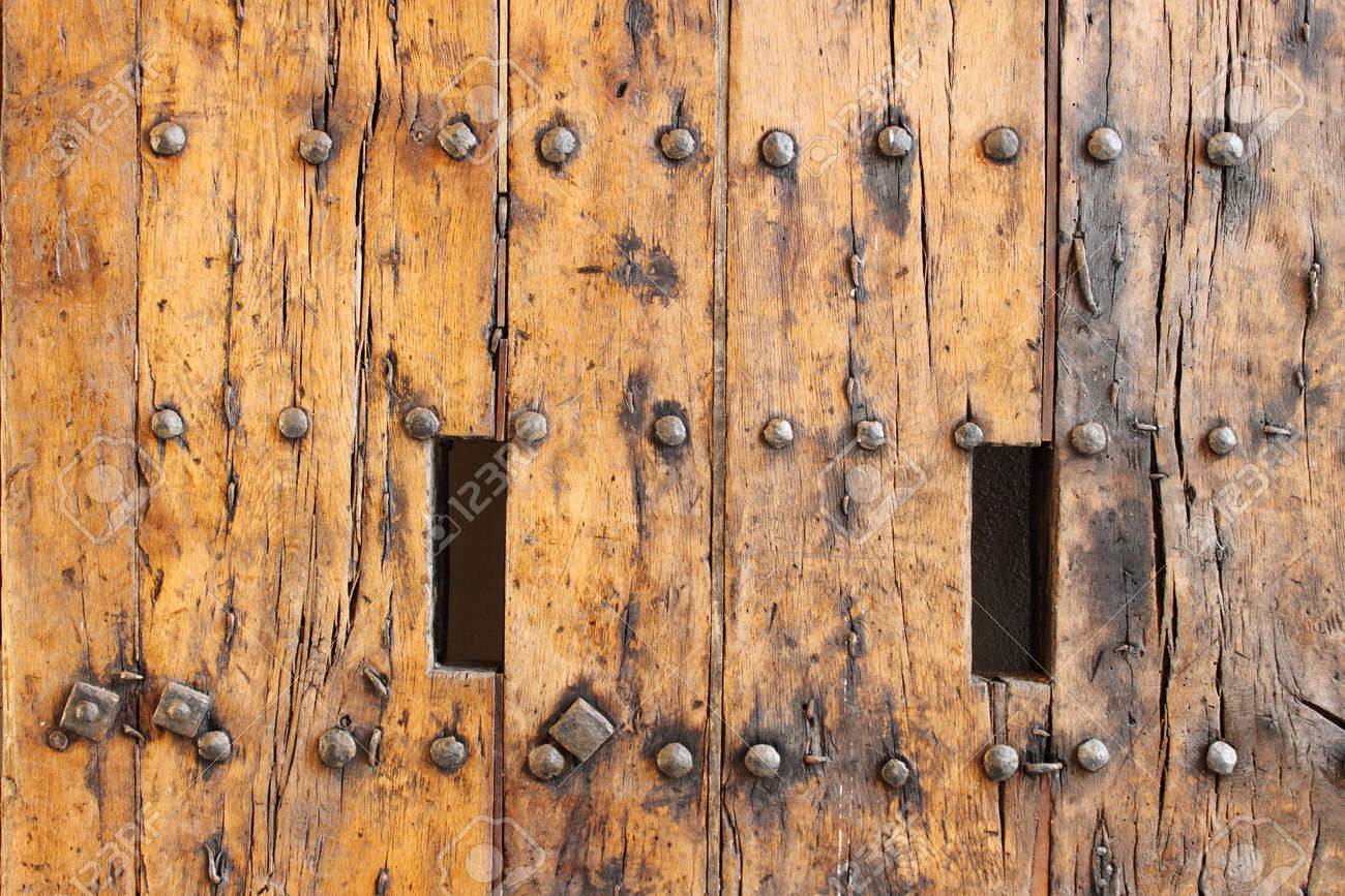 Closeup of an ancient wood front door of a castle Stock Photo - 15595712