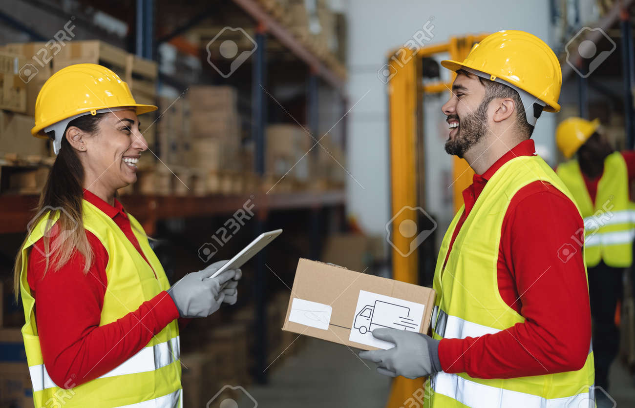 Warehouse workers doing inventory using digital tablet and loading delivery boxes plan - Logistic and industry concept - 165694113