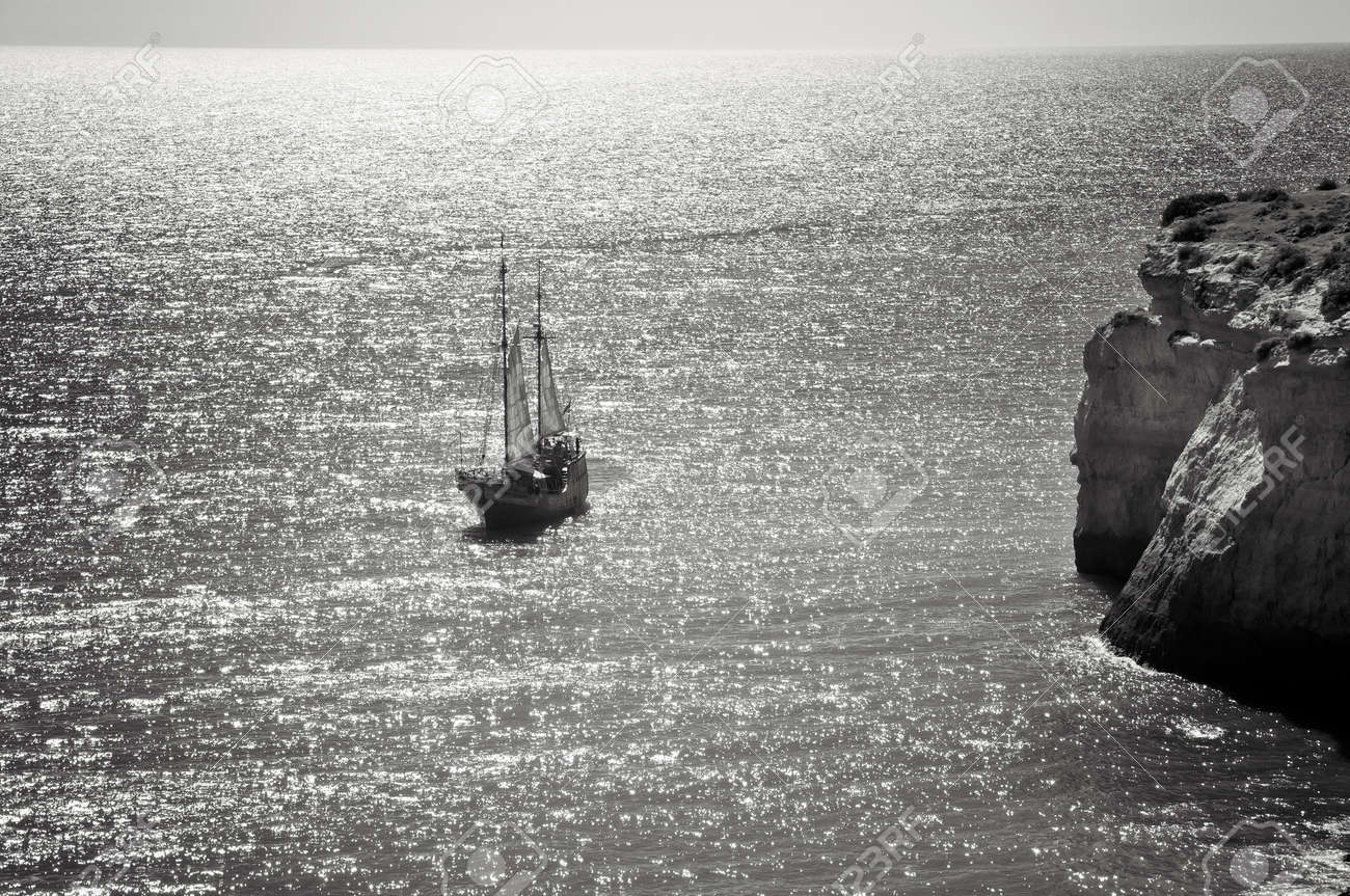 An old sailing ship on the ocean black and white photo
