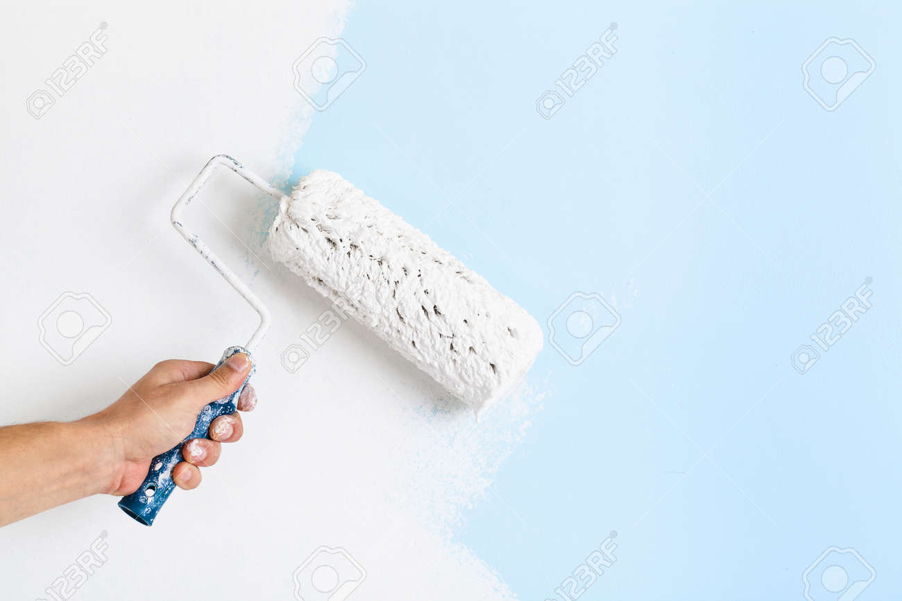 Close Up Of Painter Arm Painting A Wall With Paint Roller Copy