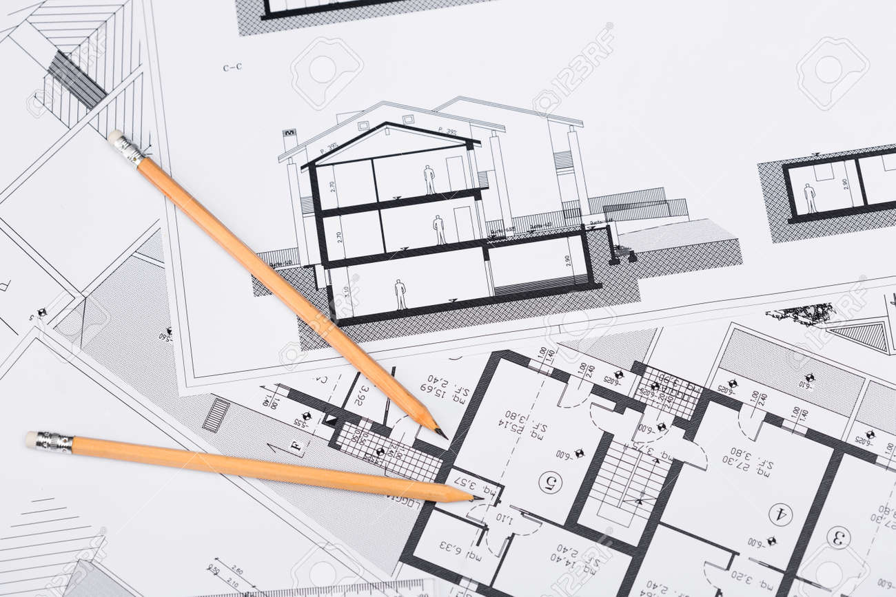 Construction plans with drawing tools on blueprints architectural construction plans with drawing tools on blueprints architectural and engineering housing concept stock photo malvernweather Gallery