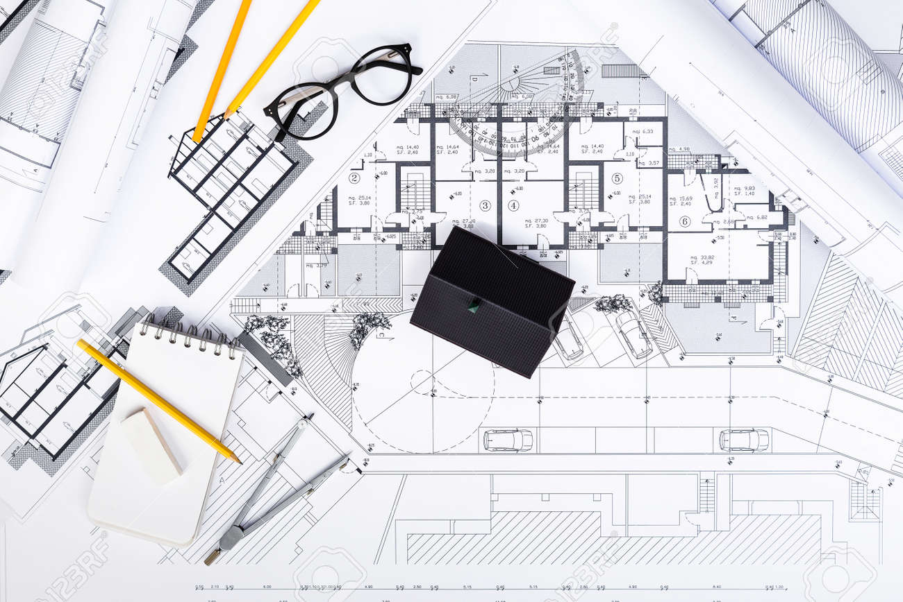 Top View Of Construction Plans With Drawing Tools And House