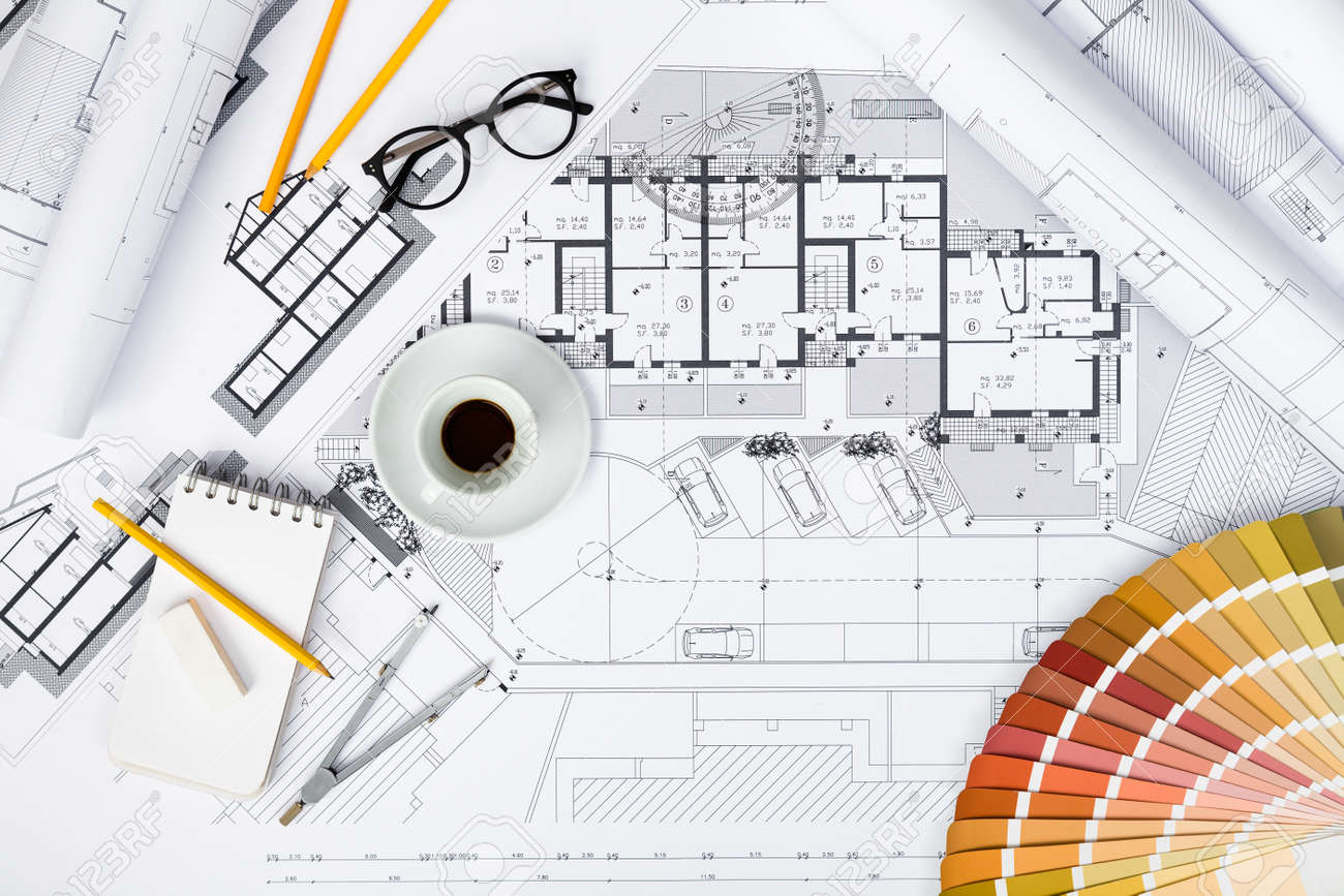Top View Of Construction Plans And Drawing Tools On Blueprints