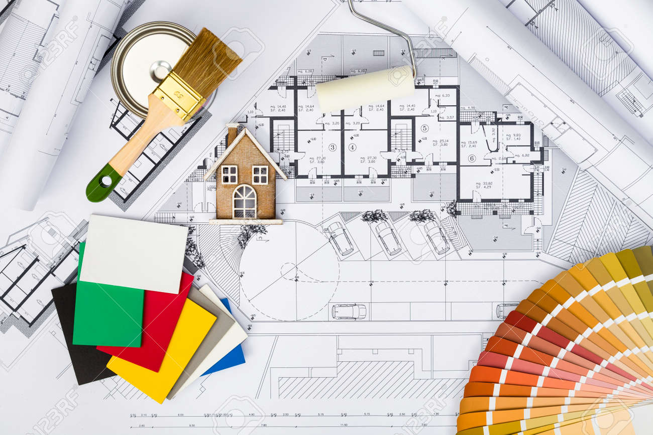 Stock Photo   Top View Of Construction Plans With Whitewashing Tools,Colors  Palette And Miniature House On Blueprints; Architectural And Engineering  Housing ...