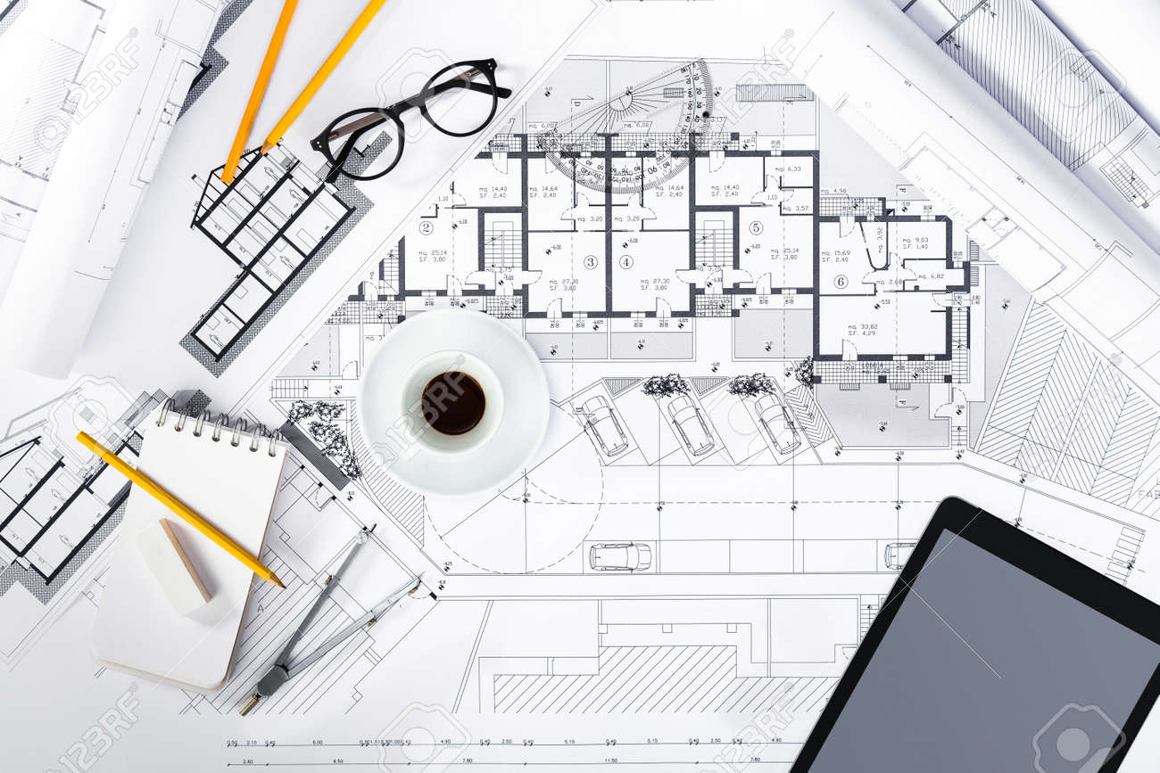 drawing tools. Stock Photo - Top View Of Construction Plans With Tablet And Drawing Tools On Blueprints; Architectural Engineering Housing Concept. E