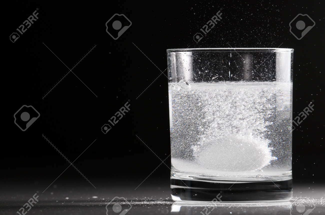 Effervescent pill in a glass of water in backlight Stock Photo - 18674432