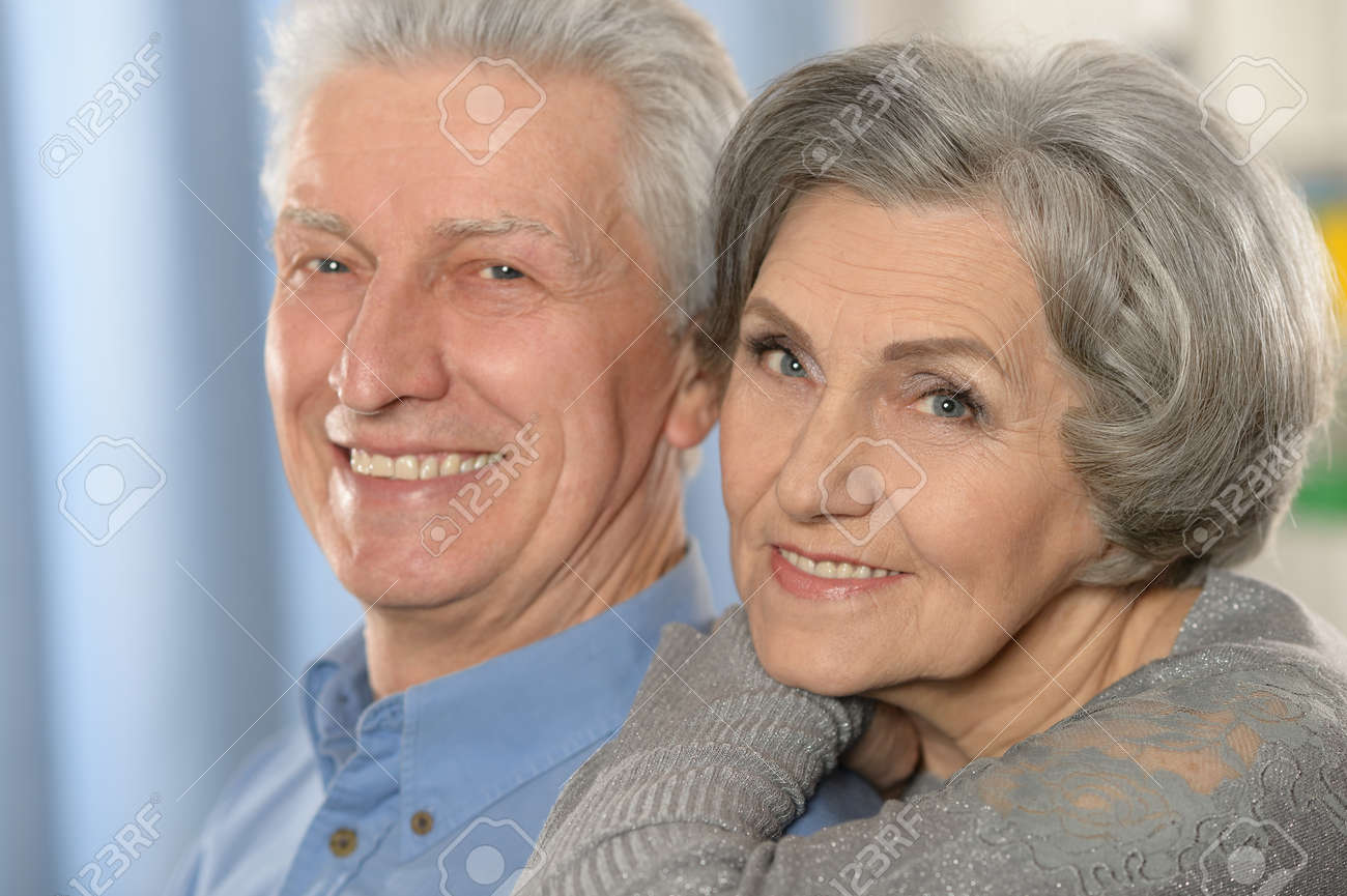 Portrait of a happy senior couple at home - 39256246