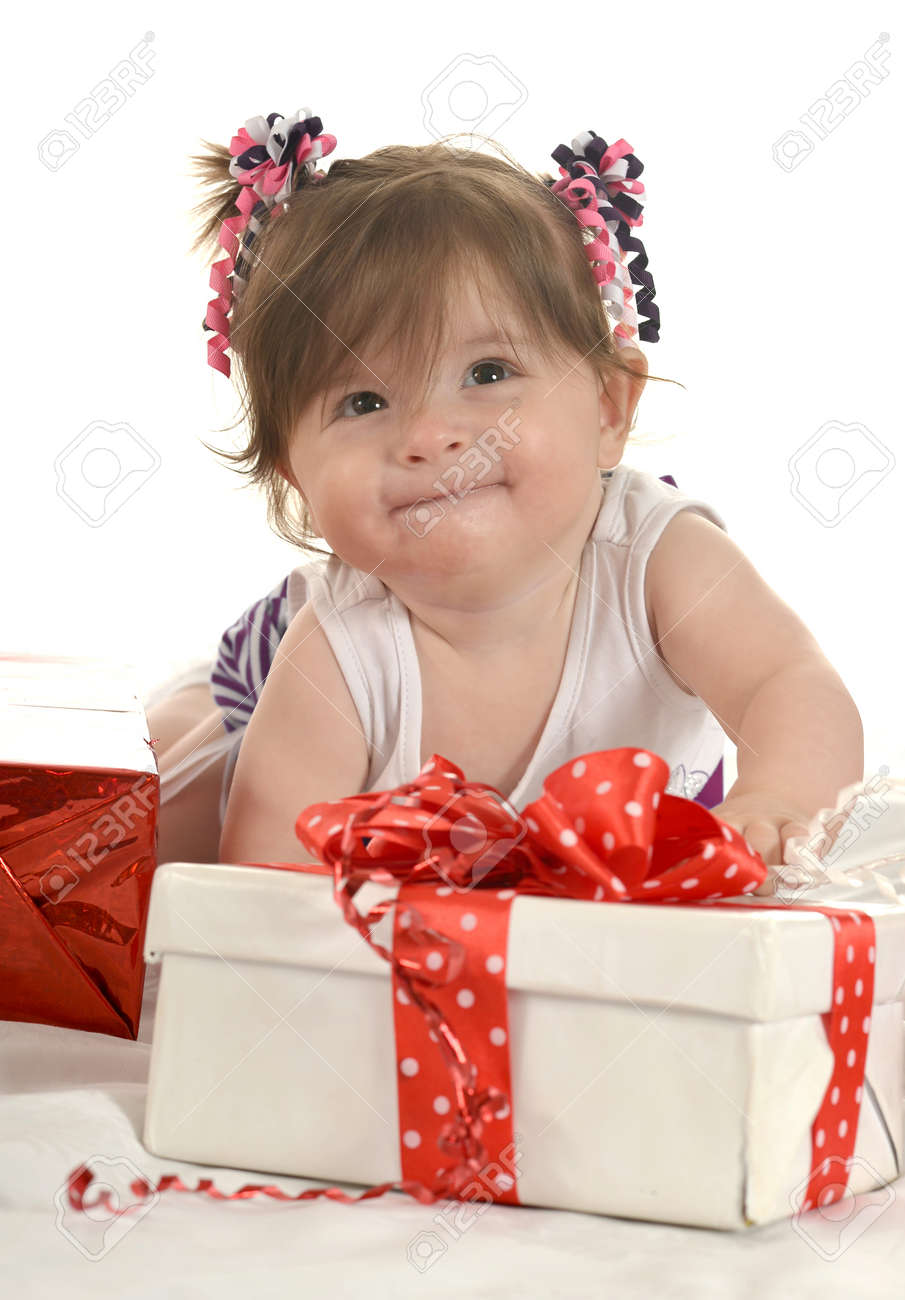 10818fcb582 Portrait of Cute baby girl with gifts Stock Photo - 42297947