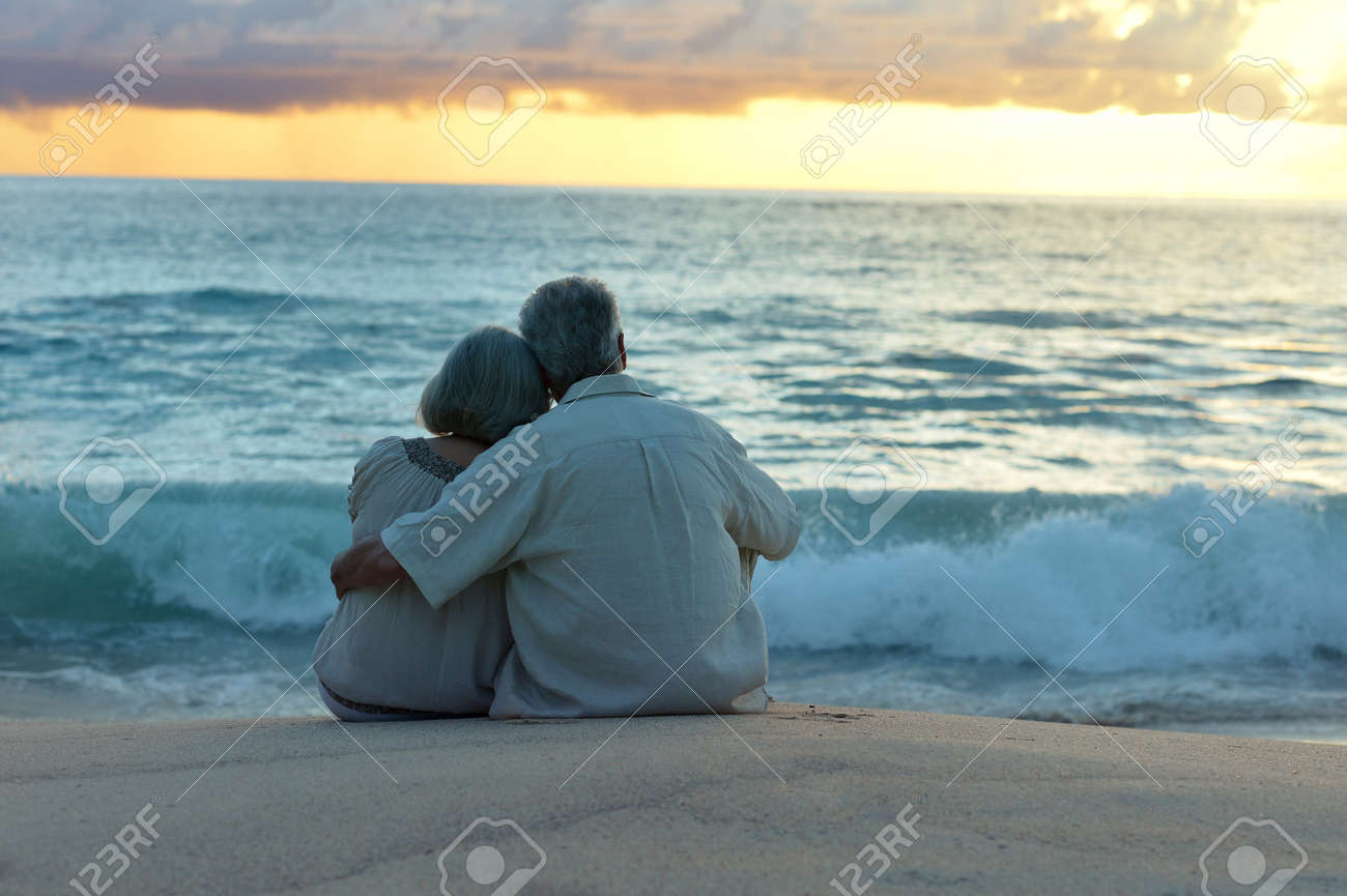 Beautiful happy elderly couple rest at tropical resort,back view - 47315789