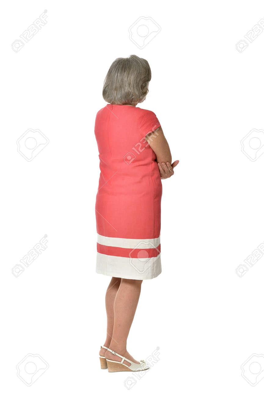 Full length portrait of senior woman in red dress,back view on white background - 47391891