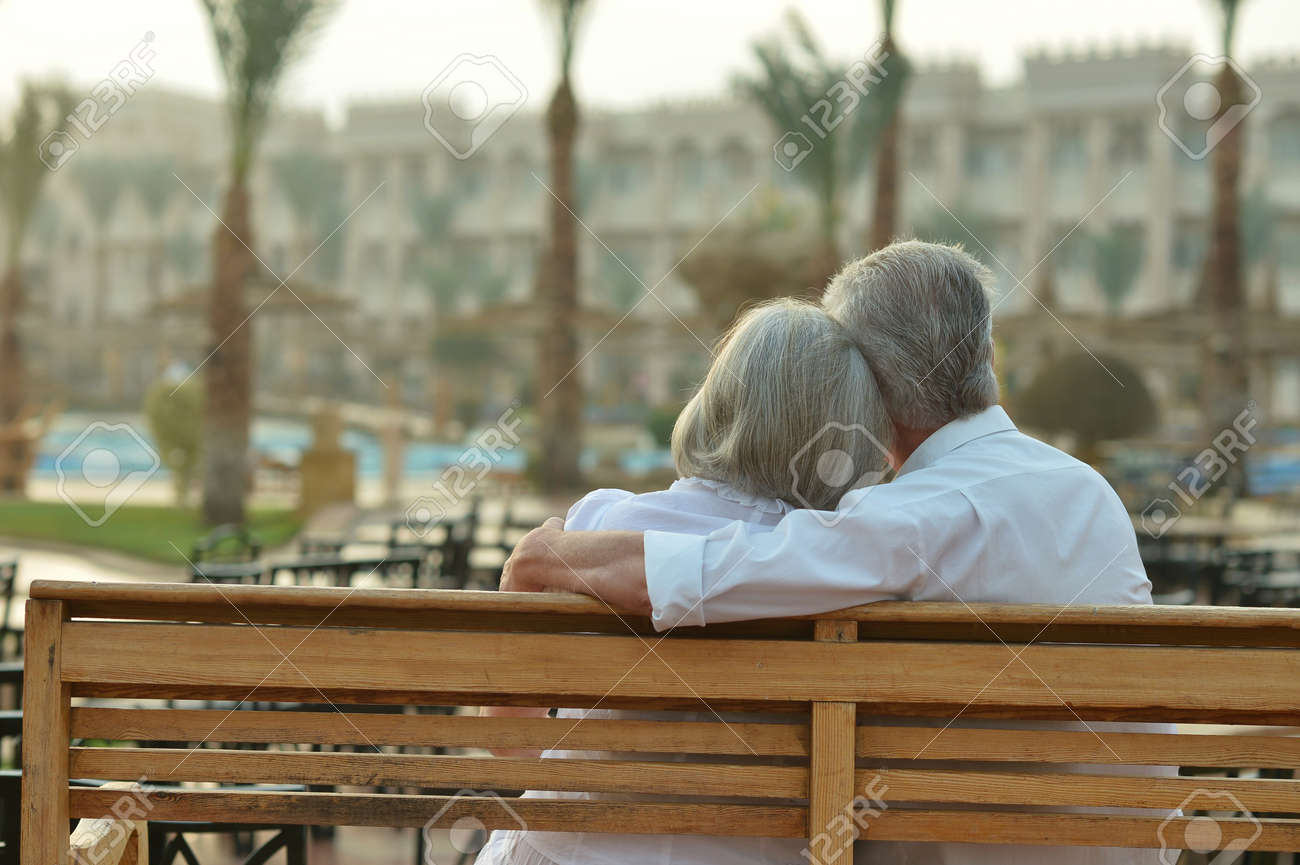 Happy Mature couple enjoy fresh air and stunning view on vacation - 47705642