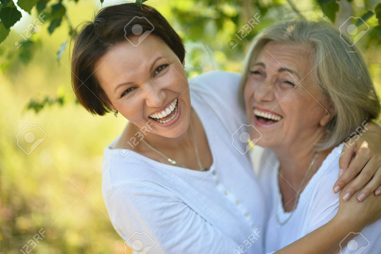 senior Mother and her nice daughter in park - 47929459