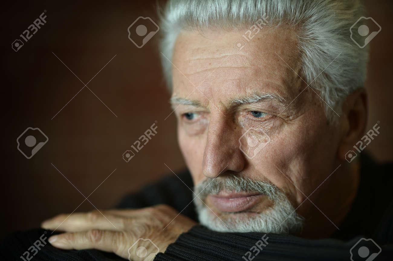 Portrait of Sad senior man at home - 47929543