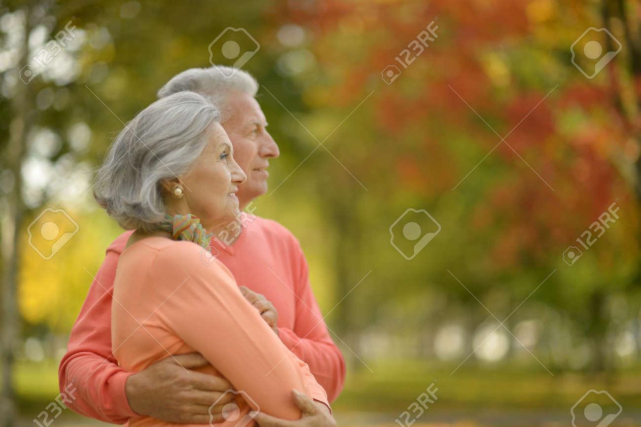 Beautiful caucasian elderly couple in the park in autumn - 48347273