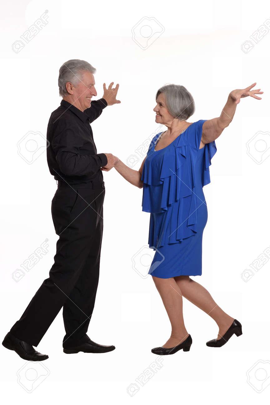 Elegant elderly couple dancing on a white background - 48616919