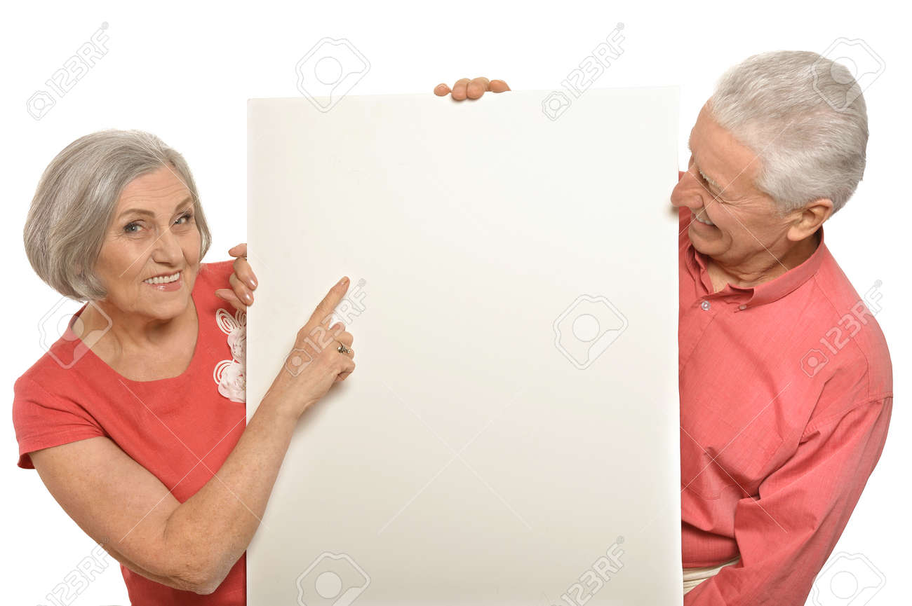 Two elderly posing with board on white - 49190292