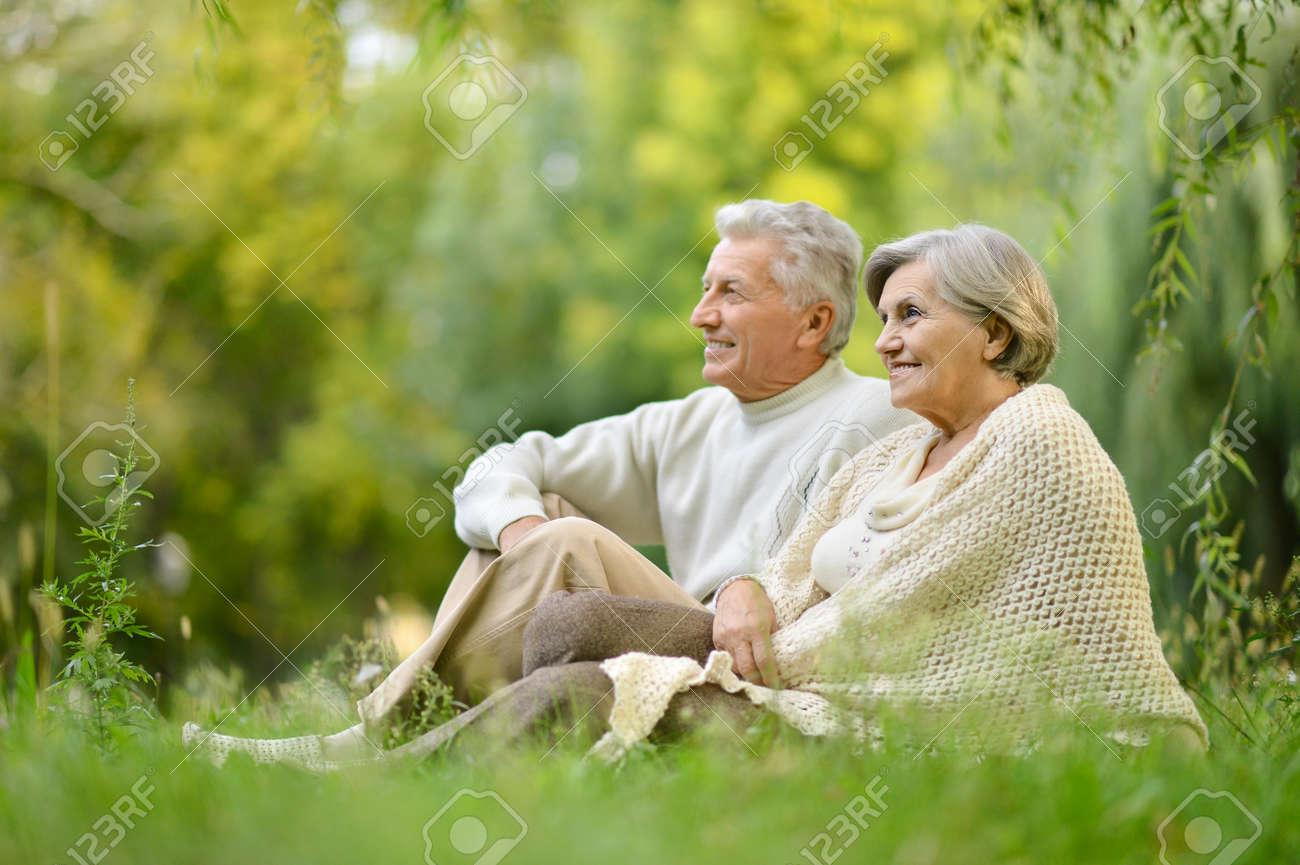 Beautiful caucasian elderly couple in the park in autumn - 55982304