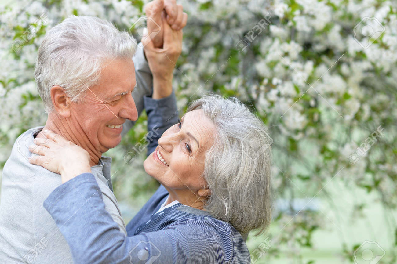 Nice Mature couple dancing in spring park - 58680578