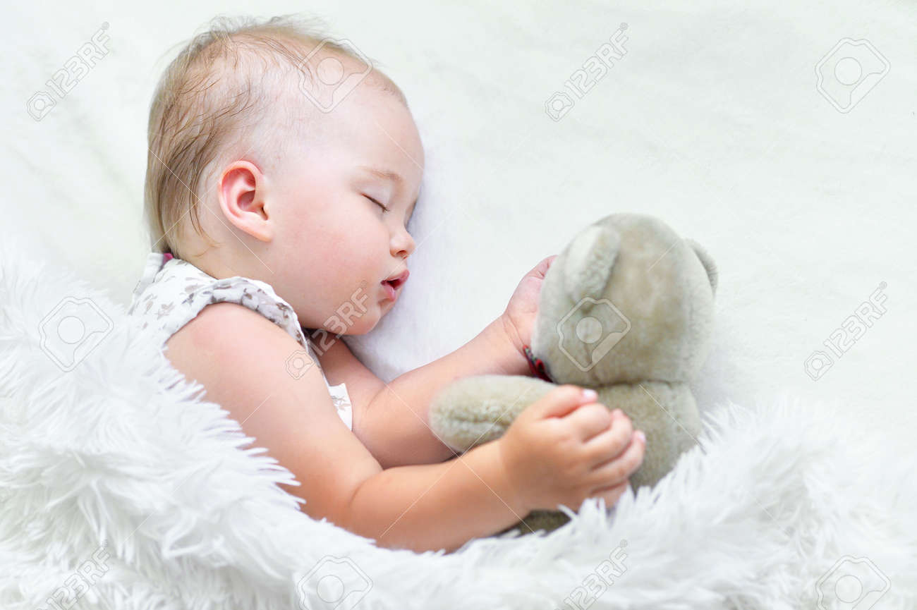 Portrait Of A Cute Sleeping Baby Girl In Bed Stock Photo Picture And Royalty Free Image Image 61908904
