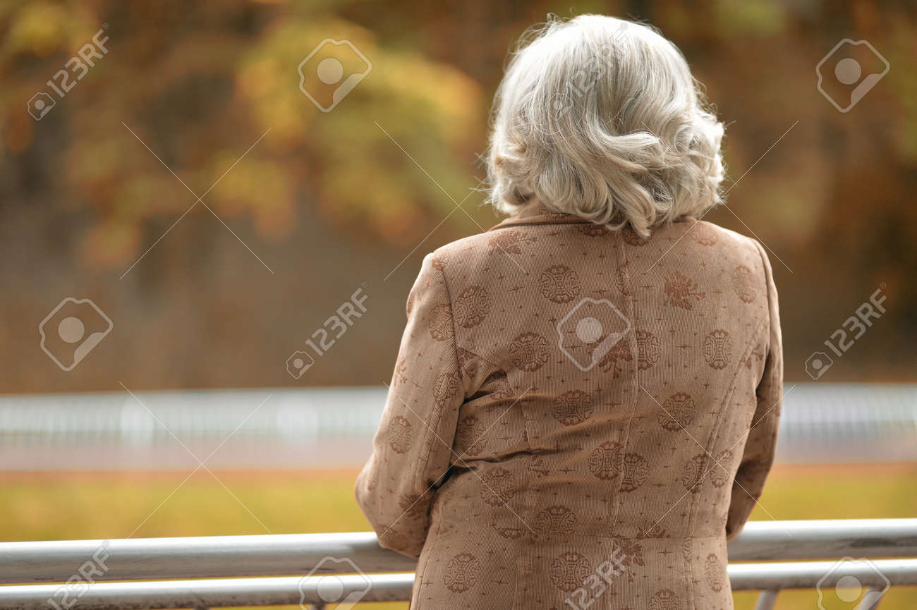 Portrait of a middle-aged woman in autumn park - 64141951
