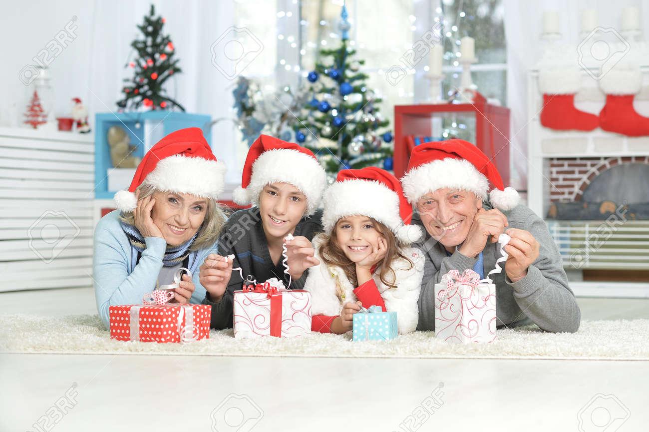 Happy Grandparents With Grandchildren Celebrating Christmas Lying ...