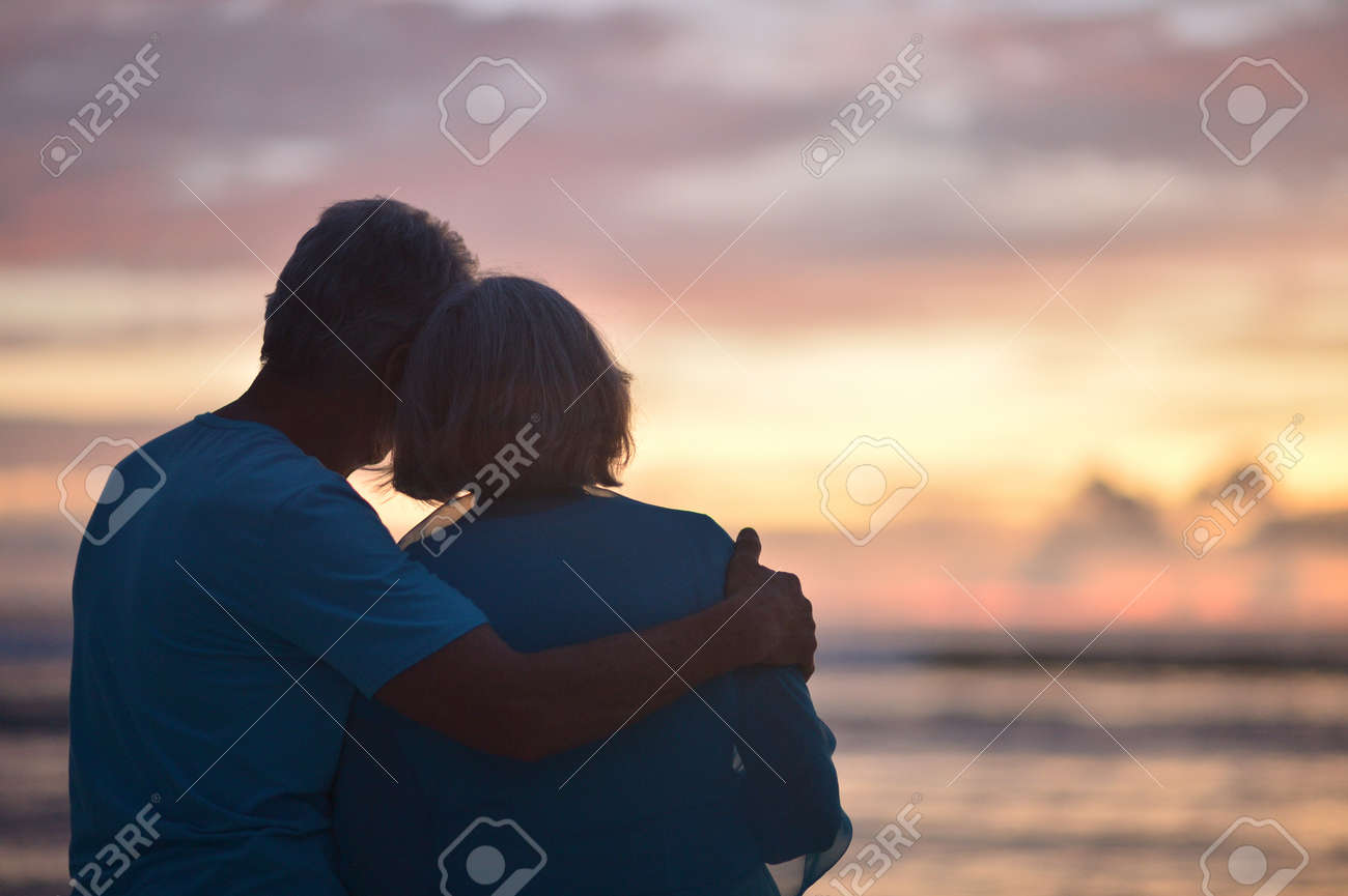 Happy elderly couple rest at tropical beach at sunset,back view - 67076145
