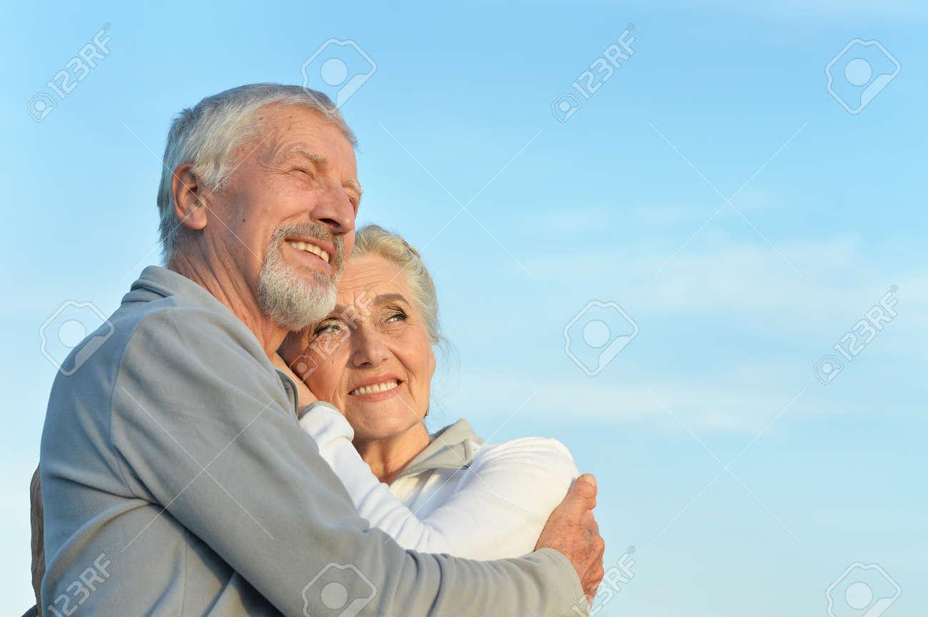senior couple hugging - 85211426