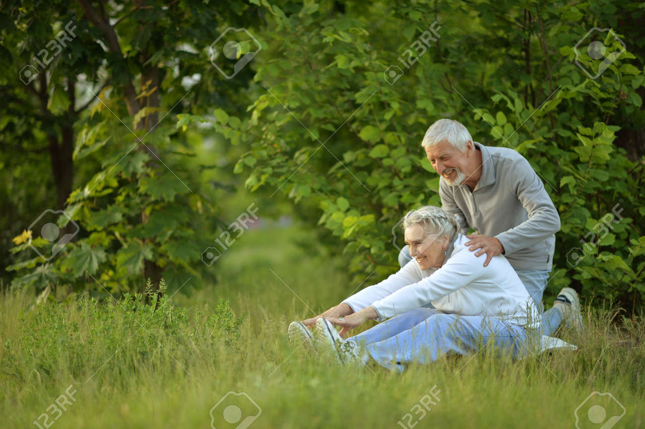 senior couple doing exercises - 85244149