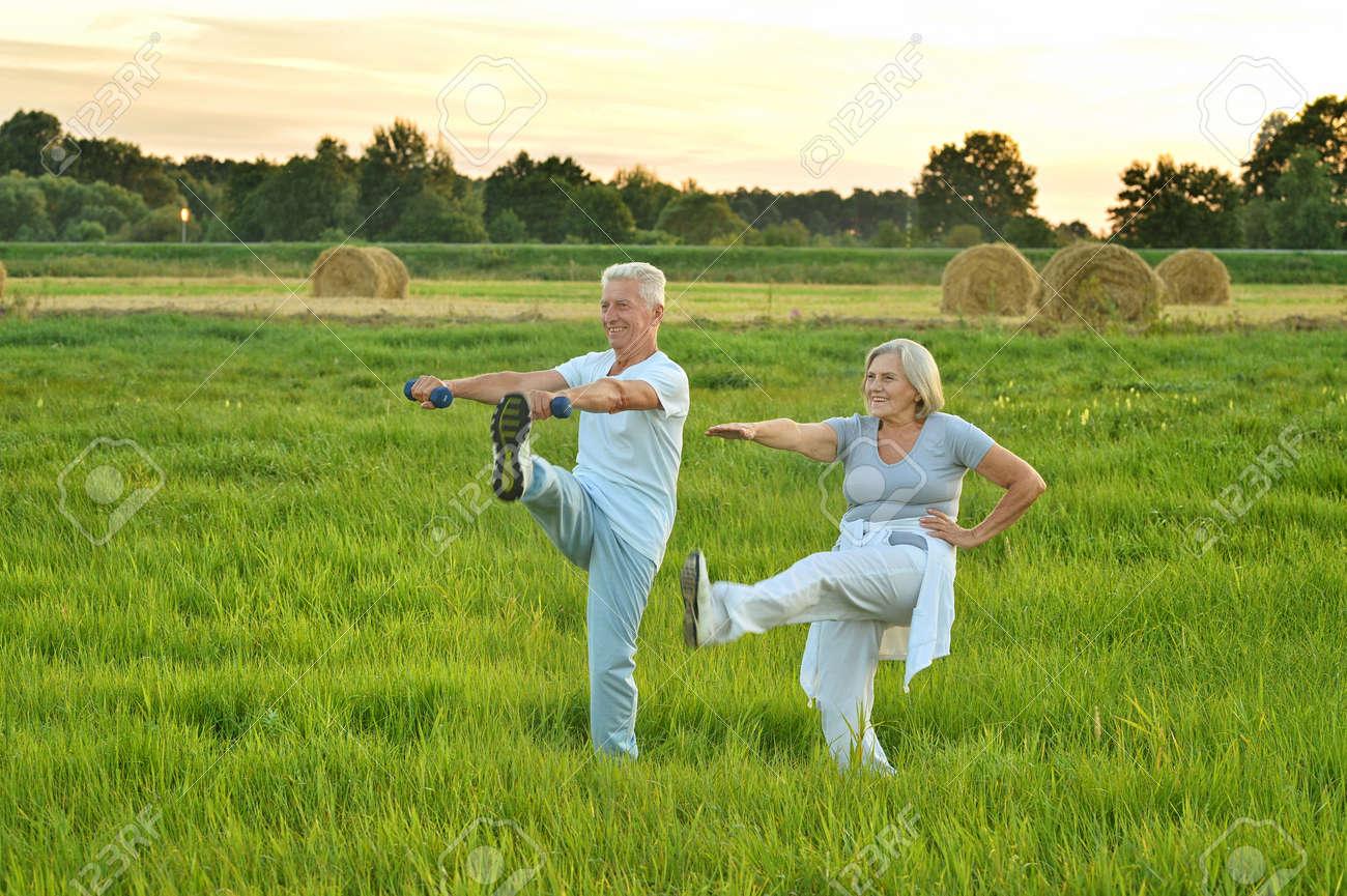 senior couple doing exercises - 94451279