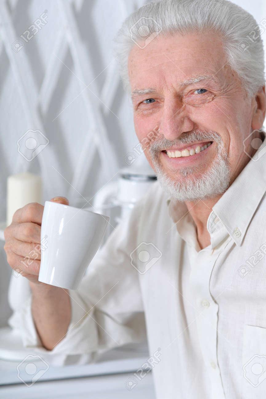 Hidan vs Karin 96938025-smiling-senior-man-drinking-tea-at-home