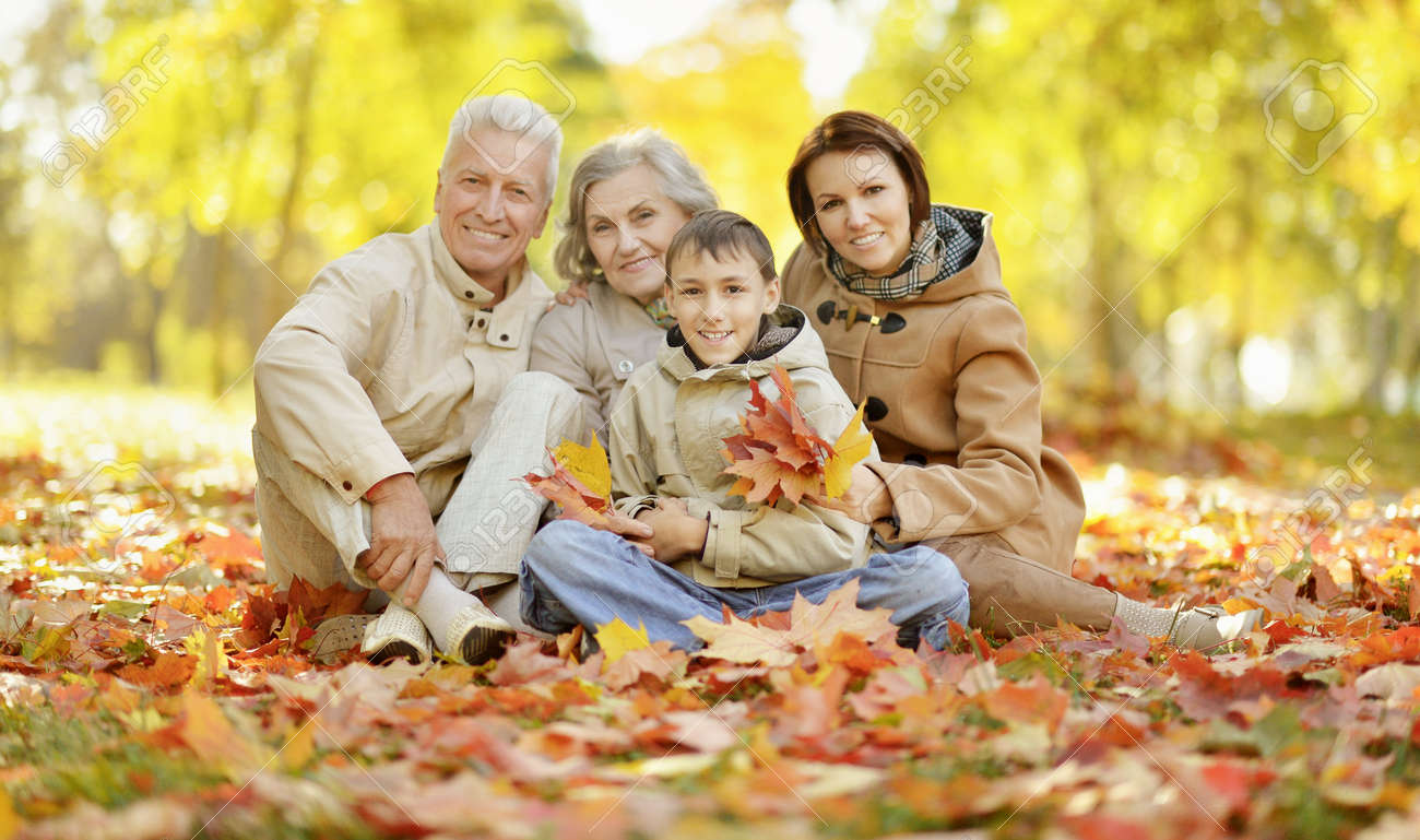 Cute happy family relaxing in autumn forest - 138471397