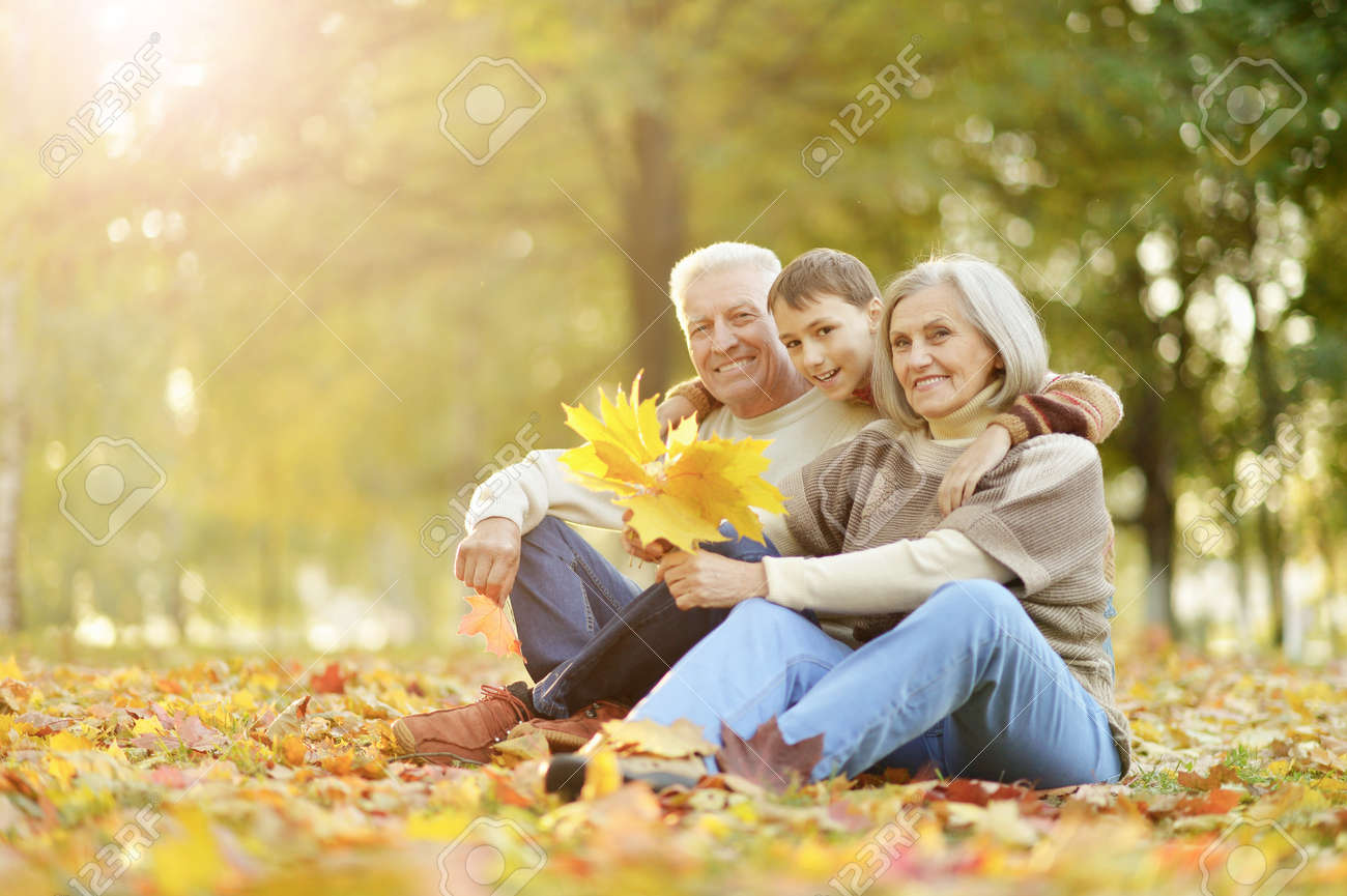 Portrait of happy grandfather, grandmother and grandson - 139291504