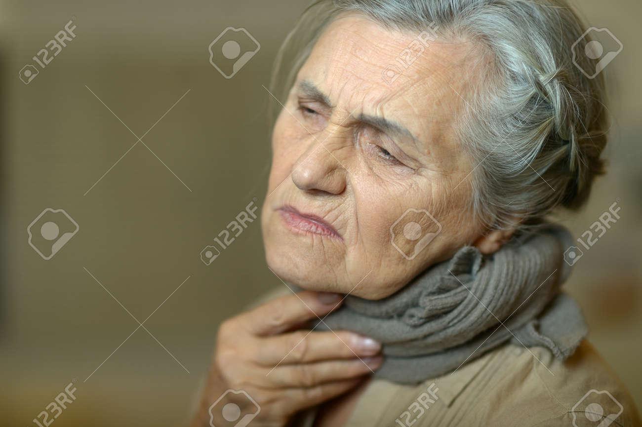 Close up portrait of sad ill senior woman - 144108681