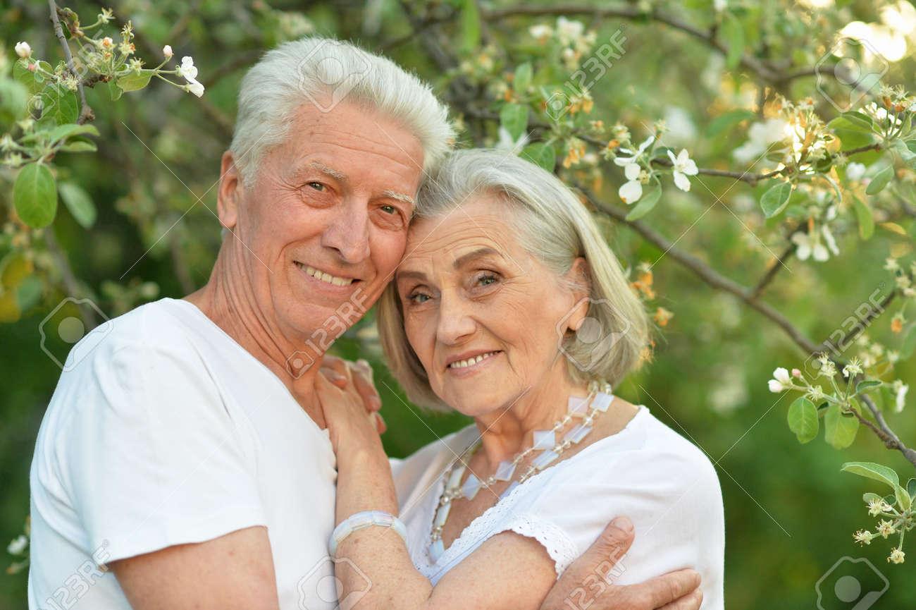 Portrait of beautiful senior couple posing in the park - 147090665