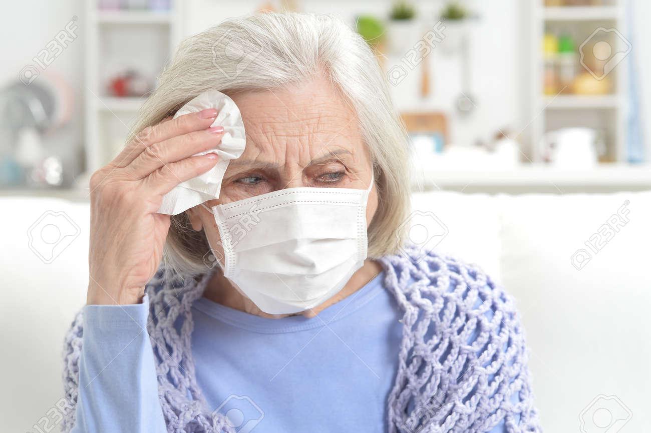 Ill beautiful senior woman with facial mask - 149075176