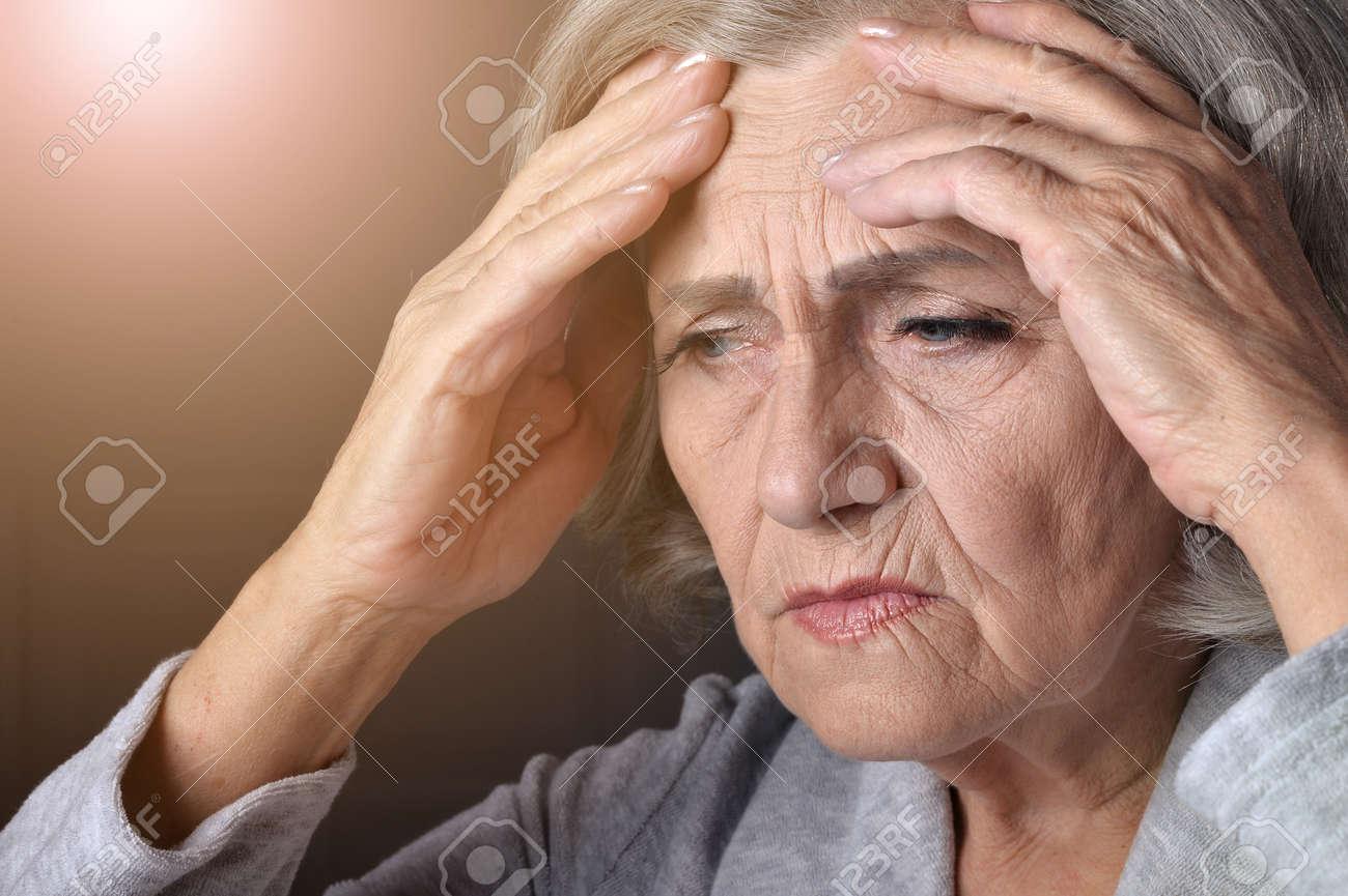 Portrait of sad senior woman at home - 149811502