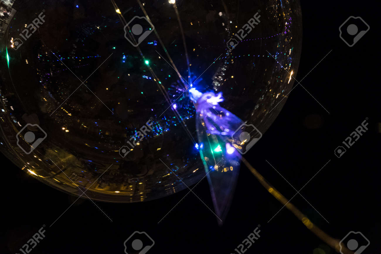 Wallpaper Background Of Led Transparent Balloon With Multi Colored Luminous Garlands At Night No People