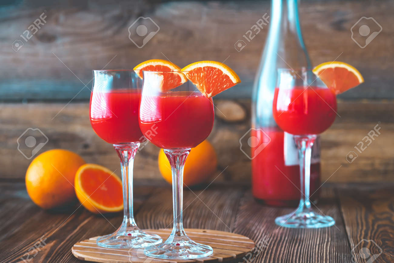 Three glasses of Mimosa cocktail on the wooden - 123713781