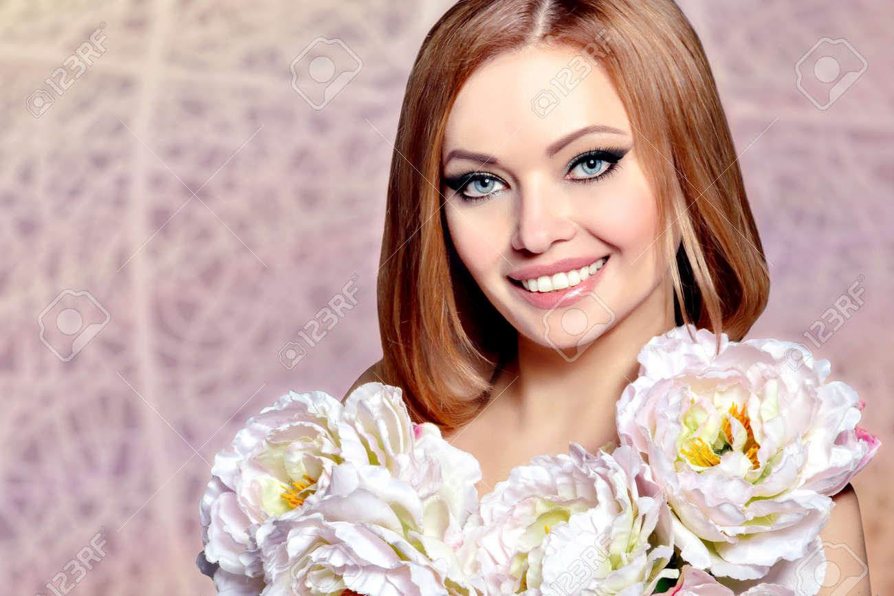 Beautiful smiling young woman model with flowers beauty face beautiful smiling young woman model with flowers beauty face perfect happy smile clear izmirmasajfo Image collections
