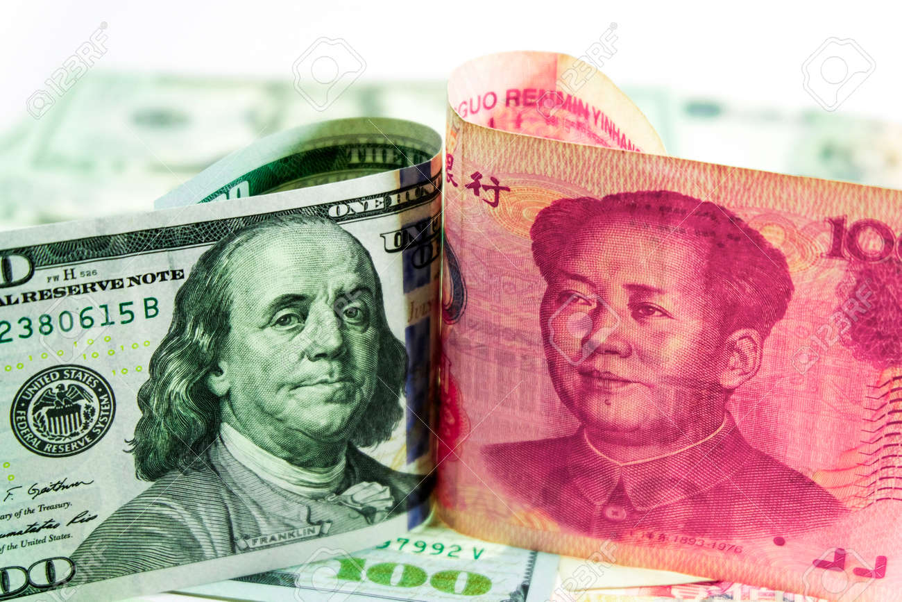 Us Dollar Bill And China Yuan Banknote America Is Debtor Of Stock Photo Picture And Royalty Free Image Image 100670171