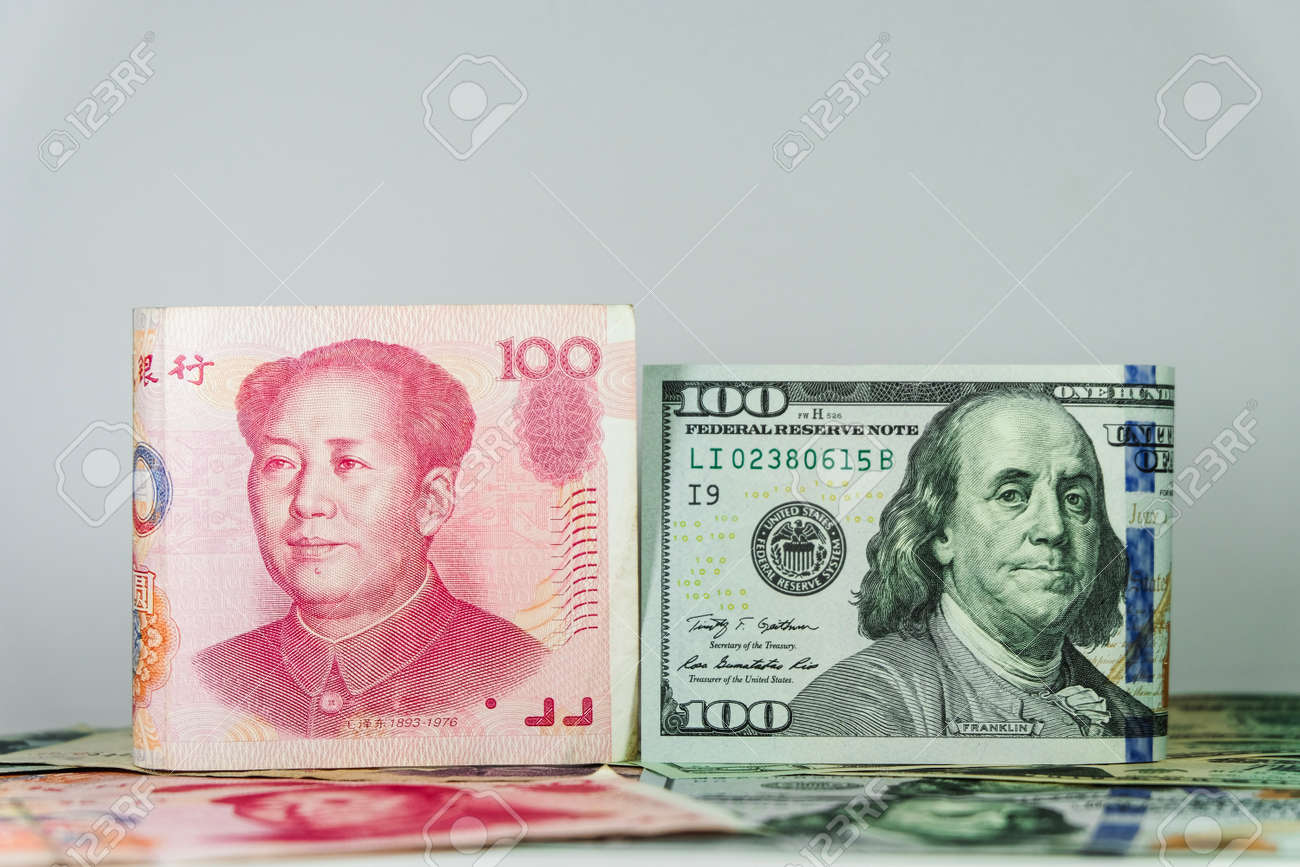 Us Dollar Bill And China Yuan Banknote America Is Debtor Of Stock Photo Picture And Royalty Free Image Image 100732840