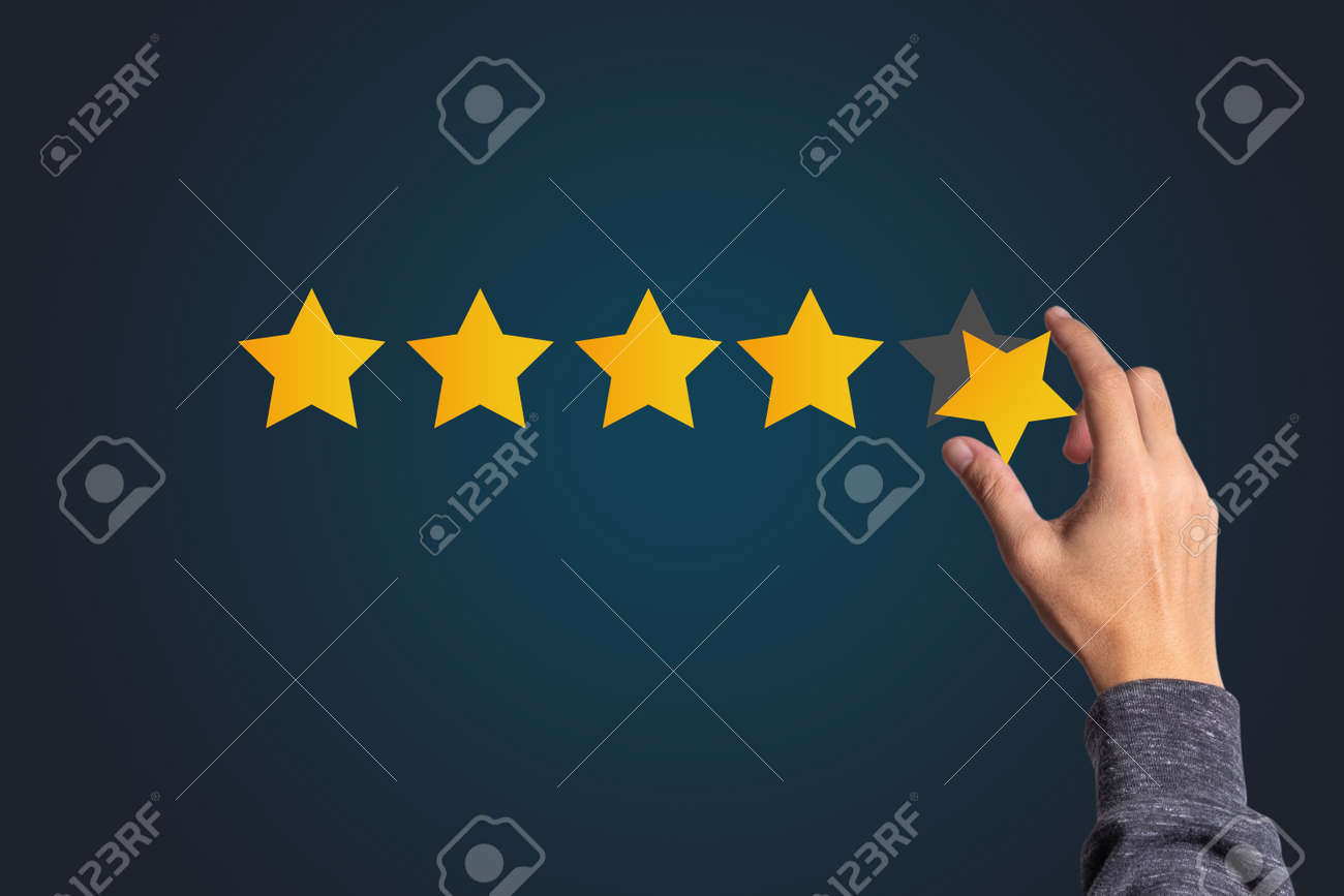 Customer satisfaction and product service evaluation concept , Hand holding and put yellow star to five stars with copy space. - 157950567